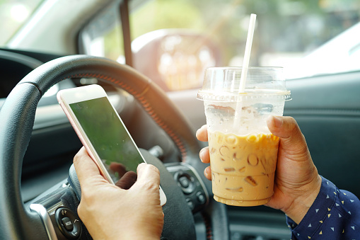 Driving while using a cellphone and drinking iced coffee