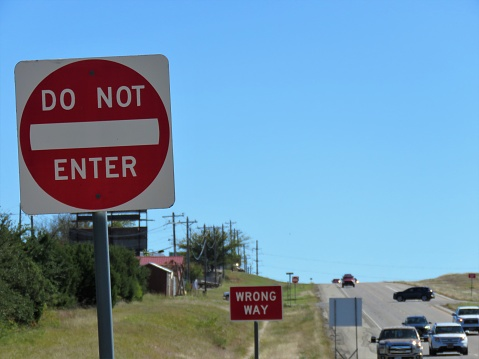 Wrong way sign on highway ramp